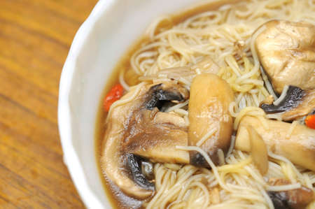 Sumptuous looking Chinese style vegetarian noodles. Made with mushrooms and herbal medicine. For concepts such as healthy lifestyle, and food and beverage. photo