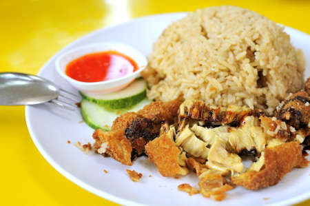 Asian style chicken chop served with rice. Suitable for concepts such as creative food, and food and beverage. photo