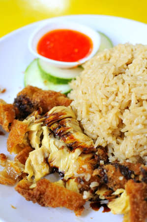 Singapore style chicken rice delicacy. Suitable for concepts such as creative food, and food and beverage. photo
