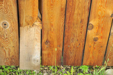 fence panel: Wooden planks showing texture and grain with one broken. For textures, backgrounds and abstract concepts. Stock Photo
