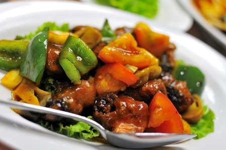 chinese menu: Colorful Asian vegetarian sweet and sour pork and mixed vegetable delicacy.