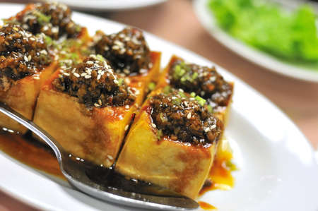 Chinese vegetarian bean curd cuisine with mock meat toppings. For food and beverage, and healthy lifestyle concepts. photo
