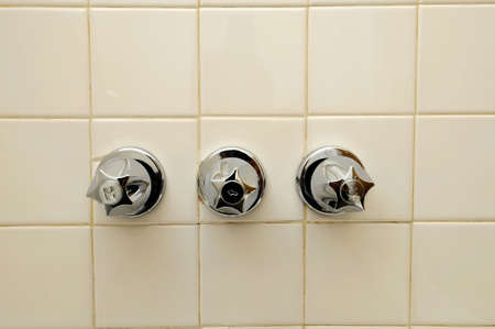 hotness: Generic knobs for adjusting water temperature in the bathroom. Suitable for concepts such as travel, tourism, vacation and holiday, spa, wellness and relaxation.