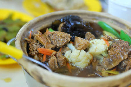 Delicious Chinese vegetarian claypot delicacy known as monkey head mushrooms. Suitable for concepts such as diet and nutrition, healthy eating lifestyle, and food and beverage. photo