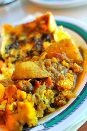 Traditional Indian vegetable curry cuisine on plate. Zdjęcie Seryjne
