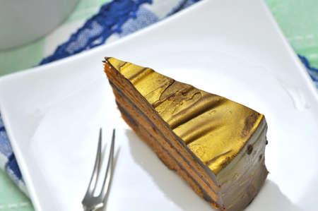 memorable: Closeup shot of slice of cake on white plate.