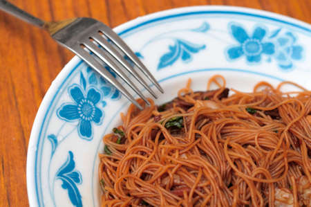 hoon: Asian vegetarian bee hoon meal served in Oriental style plate.
