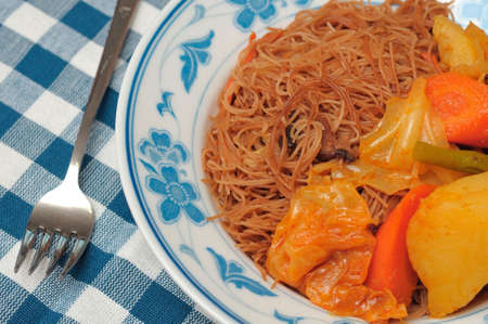 hoon: Asian style bee hoon with mixed vegetable curry. Stock Photo
