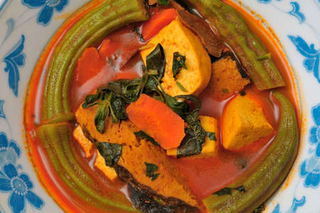 Spicy and delicious Oriental style fish and vegetable curry. photo