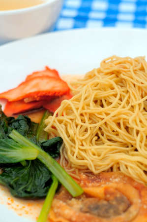 Popular dish of wanton dry noodles also known as meat dumpling noodles. photo