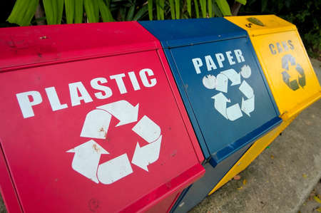blue bin: Colorful recycle bins for plastic, paper and metal waste for environment conservation.