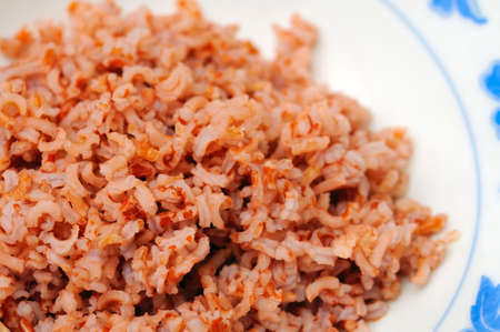 unpolished: Healthy red unpolished rice commonly found in an Asian diet. Unpolished rice is known for its abundant minerals, vitamins, and soluble fiber.