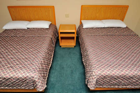 bedsheet: Simple and comfortable generic hotel with twin beds.