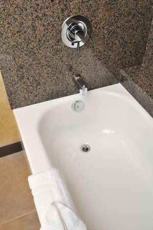 Closeup shot of comfortable bathtub in bathroom. photo