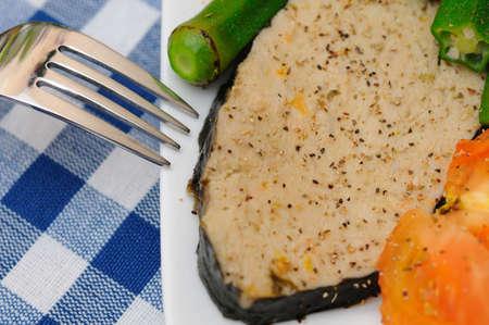 Macro shot of seasoned vegetarian fish cooked Asian style. photo
