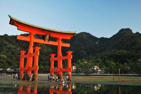 Majestic torii gate taken on September 4, 2008 in Hiroshima, Japan. Tourists can walk out to the gate during low tide.
