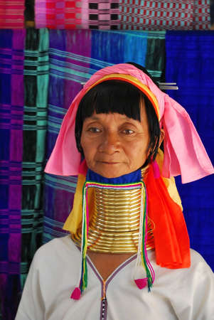 Portrait of elderly long necked Karen tribeswoman in traditional costume.