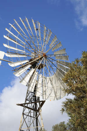 generate: Large manual windmill used to generate electricity in the rural areas. Stock Photo
