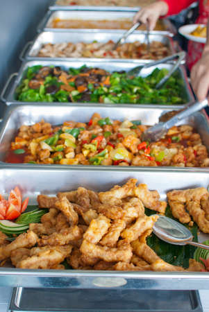 Colorful and delicious looking buffet style delicacies served in trays.
