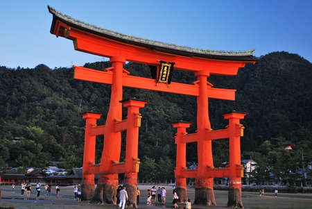 buddhist structures: Majestic torii gate of Itsukushima Shrine taken on September 4, 2008 in Hiroshima, Japan.