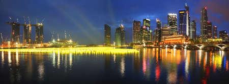 lightup: SINGAPORE - DECEMBER 31: Beautiful panorama of Singapore city at Marina Bay taken on December 31, 2009 in Singapore.