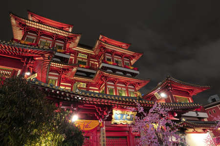 lightup: Night view of Buddha tooth relic temple in Singapore. Editorial