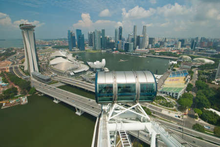 SINGAPORE - JUNE 12: Breathtaking view of the Singapore skyline from the Singapore flyer at Marina Bay, taken on June 12, 2011 in Singapore. Stock Photo - 10582046