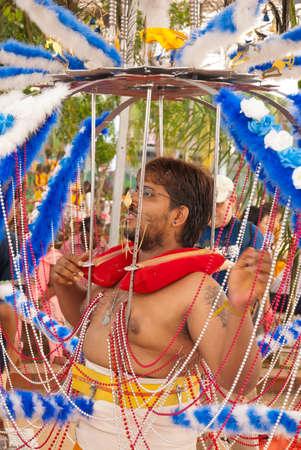 kavadi: SINGAPORE - JANUARY 30: Hindu devotee carrying a heavy kavadi at Thaipusam taken on January 30, 2010 in Singapore.