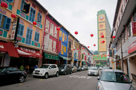 singapore culture: Colorful street in Chinatown with historical architecture preserved from the colonial days. Editorial
