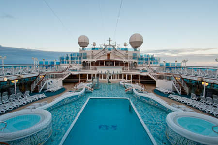 View of top deck of cruise ship with luxurious pools and spa facilities. Editorial