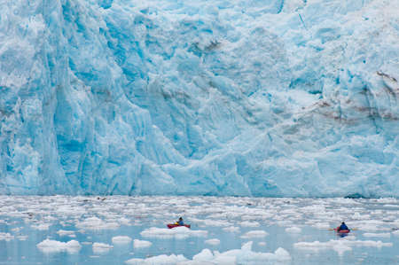 Kayaking near the foot of majestic Surprise Glacier.
