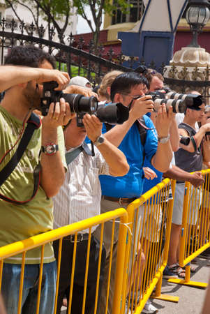 SINGAPORE - JANUARY 30: Crowd of photographers posing to get a shot at Thaipusam taken on January 30, 2010 in Singapore. Stock Photo - 10678227