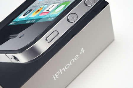 New Apple iPhone 4 in product box with white background. Editorial