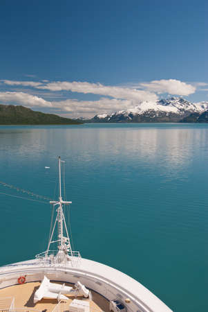 View of sailing cruise ship bow in Glacier Bay National Park in Alaska. photo