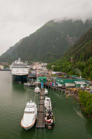 View of port of small Juneau town with boats and cruise ships anchored.