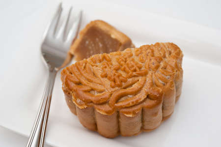 Macro shot of traditional Oriental mooncake on white plate for dessert. photo