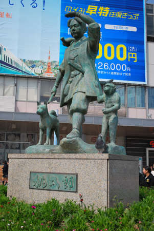legends folklore: JAPAN - MARCH 25: Momotaro bronze statue taken on March 25, 2008 outside Okayama railway station in Japan. Momotaro is a popular hero from Japanese folklore closely linked to Japanese culture.