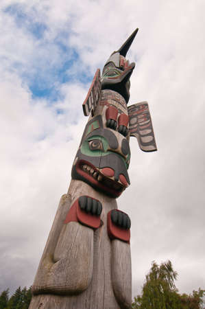 Tall towering totem pole built by the aborigines in Alaska.