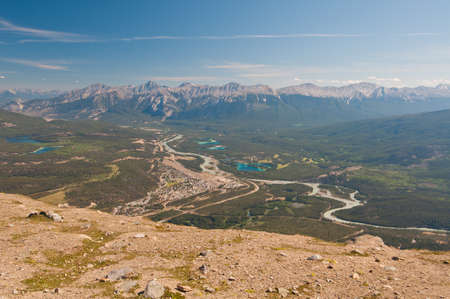 Panoramic view of town of Banff with majestic mountain range in background. Stock Photo - 11493429