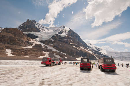 icefield: Huge Ice Explorer vehicles parked on Colulmbia Icefield. Editorial