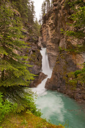 Landscape shot of waterfall at Johnston Canyon in Alberta. photo