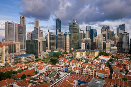 singapore city: Singapores modern skyline with historical buildings in foreground at sunset. Taken 06 February 2016.
