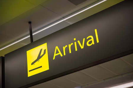 denote: Sign to denote flight and passenger arrivals at airport. Stock Photo