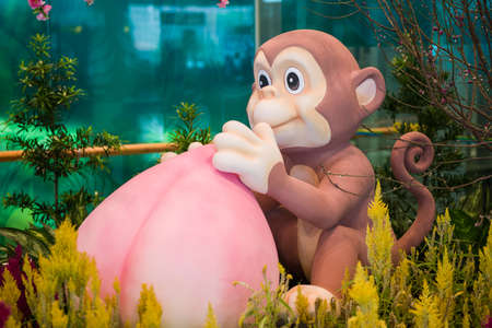 customs and celebrations: Monkey mascot with longevity peach for good luck.