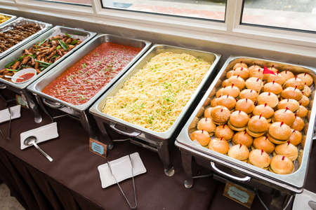 western food: Gorgeous buffet spread of Western food of burgers and pasta. Stock Photo