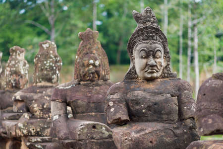 angkor thom: Ancient statues carved out of stone at Angkor Thom kingdom.