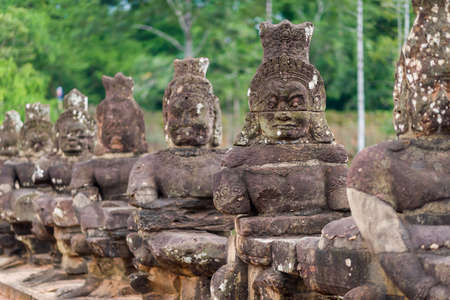 angkor thom: Siem Reap, Cambodia, 13 Nov 2015: Ancient statues carved out of stone at Angkor Thom kingdom.
