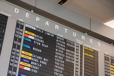Singapore, 11 Feb 2016: Huge display board for flight information for departures at Changi Airport, Singapore.