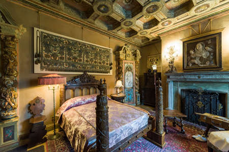 historical building: California, USA, 09 Jun 2013: Beautiful and luxurious bedroom with intricate carvings and designs at Hearst Castle, which is a National and California Historical Landmark opened for public tours.