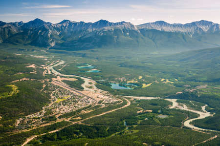 Aerial, birds eye view of town of Banff from Mount Jasper.